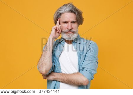 Dissatisfied Puzzled Elderly Gray-haired Mustache Bearded Man In Casual Blue Shirt Posing Isolated O