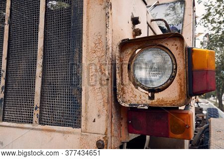 headlight and close view of old tractor parts