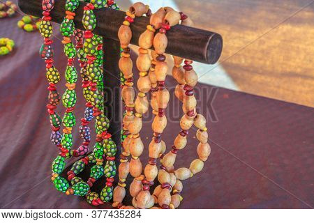 Kings Creek Station, Northern Territory, Australia - Aug 21, 2019: Native Australians Necklaces Made
