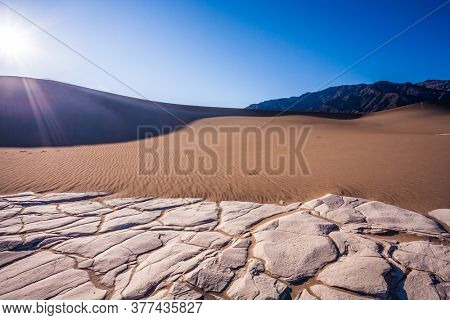 USA, California. Road 160. Mesquite Flat Sand Dunes - dunes in Death Valley. Magical desert morning.  The sand lies in light waves. The concept of active, extreme and photo tourism