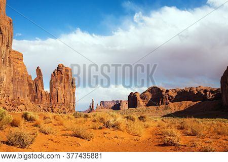Monument Valley is a unique geological formation. The USA. Huge masses of red sandstone - outliers on the Navajo Indian Reservation. The Elephant Butte. The concept of photo tourism