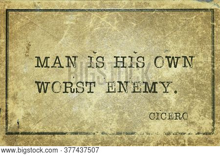 Man Is His Own Worst Enemy - Ancient Roman Philosopher Cicero Quote Printed On Grunge Vintage Cardbo