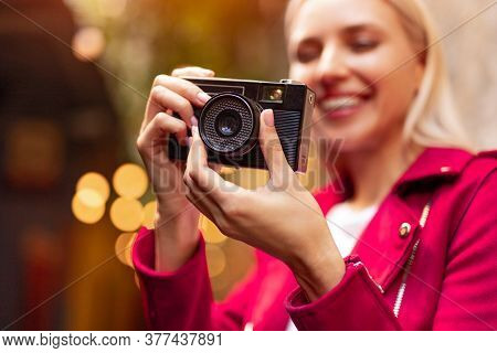 Happy Young Female Photographer Beginner Setting Lens Of Retro Photo Camera While Taking Pictures On