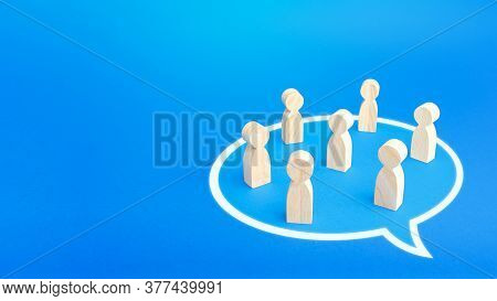 People Stand In A Conversation Cloud Bubble Shape. Active Discussion. Taking Part In The Discussion