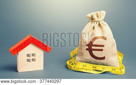 House And A Euro Money Bag. Property Real Estate Valuation. Buying And Selling, Fair Price. Building