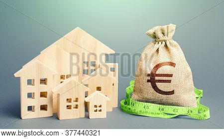 Residential Houses And A Euro Money Bag. Property Real Estate Valuation. Buying And Selling, Fair Pr
