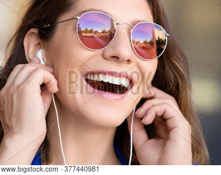 Happy Laughing Woman In Sunglasses Win Headset Listening To The Music.