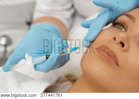 Cropped Close Up Of A Young Beautiful Woman Getting Fillers Injection In Her Face Receiving Beauty F