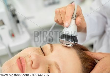 Professional Cosmetologist Working With Her Client At The Beauty Clinic