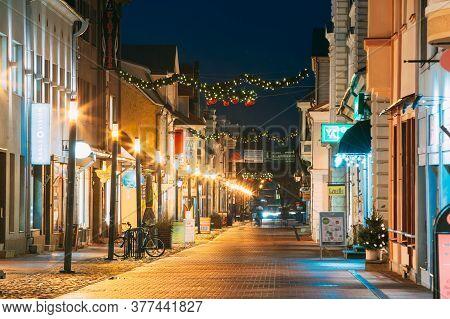 Parnu, Estonia - December 13, 2017: Night View Of Famous Ruutli Street With Old Buildings, Restauran