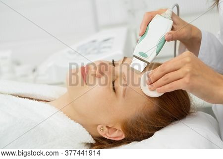 Beautiful Woman Getting Ultrasound Facial Cleansing At Beauty Clinic