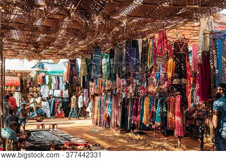 Anjuna, Goa, India - February 19, 2020: Man Seller Sells Indian Souvenirs And Clothes In The Anjuna