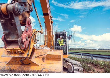Woman construction worker with excavator on site for earthworks