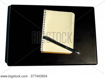 Blank Loose-leaf Notebook And Meta Ballpoint Pen Lie On Notebook On White Background
