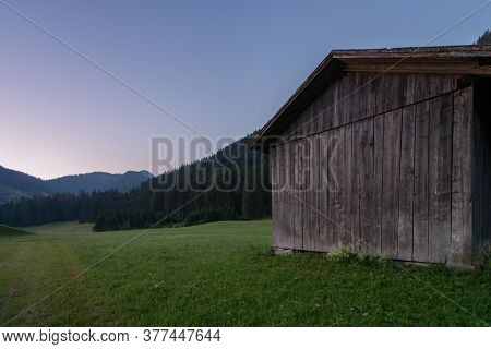 Wooden Shed Immersed In The Mountain Landscape Of The Val Pusteria In The Dolomites Of South Tyrol