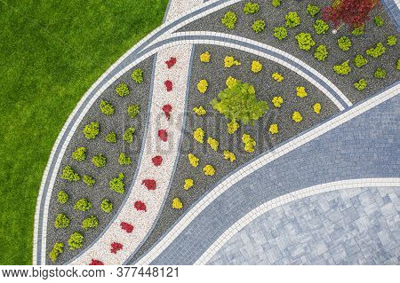 Elegant Front Yard Garden With Brick Paved Driveway Aerial View. Modern Gardening And Landscaping Th