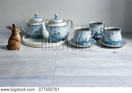 A Blue Porcelain Tea Set On The Table. Teapot And Cups Of Tea.