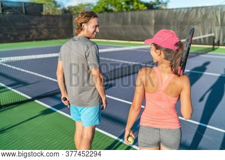 Tennis court players couple playing outside recreational activity for summer outdoors as team. Fun sport for two friends, leisure active lifestyle.