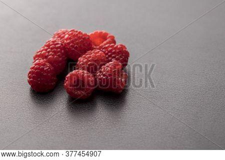 Close Up Of Backlit Raspberries In A Studio.