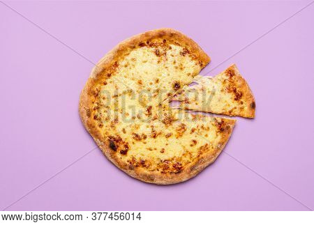 Homemade Regular Cheese Pizza With One Slice Cut, Isolated On A Purple Seamless Background. Flat Lay