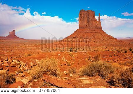 Monument Valley is unique geological formation. The USA. The Mittens. Huge masses of red sandstone - outliers on the Navajo Indian Reservation. The concept of active and photo tourism