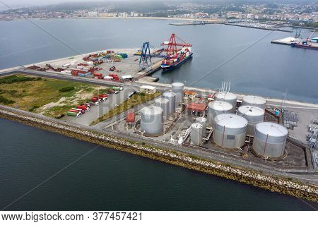 Aerial View Of An Industrial Tanks For Fuel In A Seaport, Shooting From A Drone