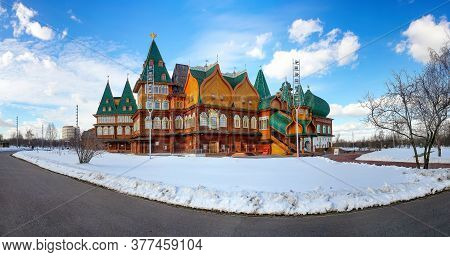 Wooden Palace In Kolomenskoye. Winter Landscape With Snow On A Background Of Blue Sky With Clouds In