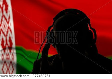 Silhouette Of A Man In Headphones, Secret Agent Eavesdropping, Spy And Intelligence Officer, Belarus