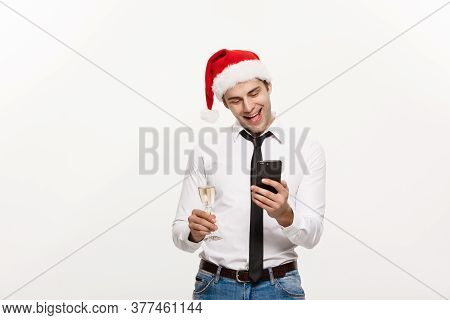 Christmas Concept - Handsome Business Man Talking On Phone And Holding Glass Of Champange Celebratin