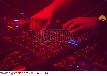 Dj Plays Techno Music On The Equipment Desk At Night Club