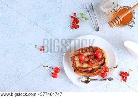 French Toast With Honey, Milk And Berries. Fried Bread With Milk And Scrambled Eggs, Modern Bakery C
