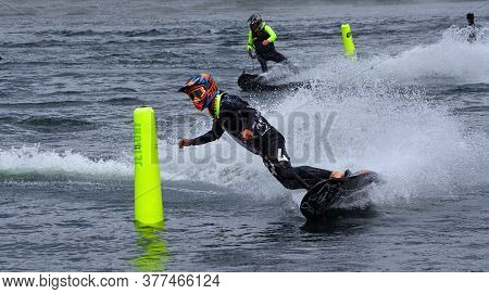 Wyboston, Bedfordshire, England - July 07, 2019: Male Motorsurf Competitor Cornering At Speed.