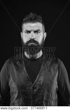 Confident And Stylish. Serious Hipster Dark Background. Bearded Man In Trendy Hipster Style. Brutal