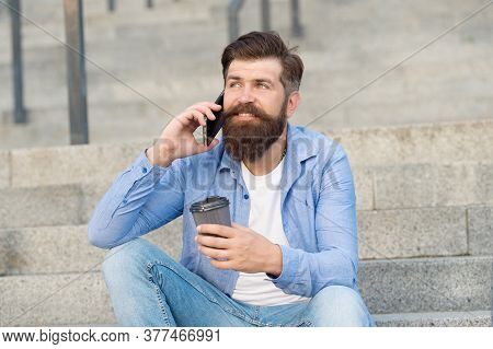 Pleasant Conversation. Real Connect. Drink Coffee While Talking. Modern Urban Life. Bearded Man Phon