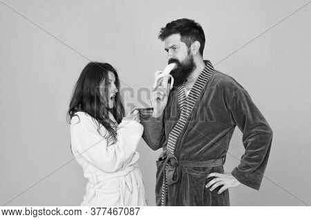 Sweet Banana. Seductive Hipster Eat Banana Infront Of Woman. Using Seduction Tactics In Family Life.