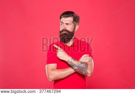 Promoting Barber Services. Portrait Of Bearded Man Red Background. Brutal Guy With Mustache. Hipster