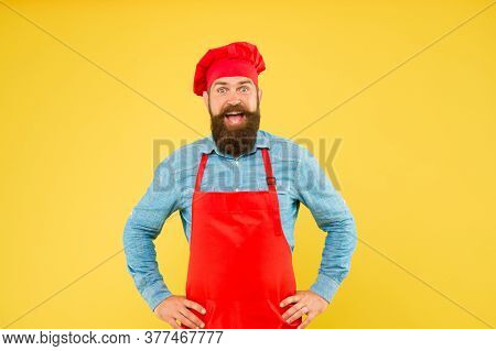 Celebrating Catering. Male Chef In Red Uniform. Mature Hipster With Surprised Face. Satisfied Bearde