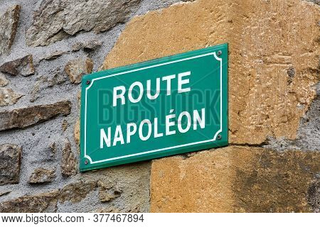 Signboard On A Wall With Route Napoleon In France