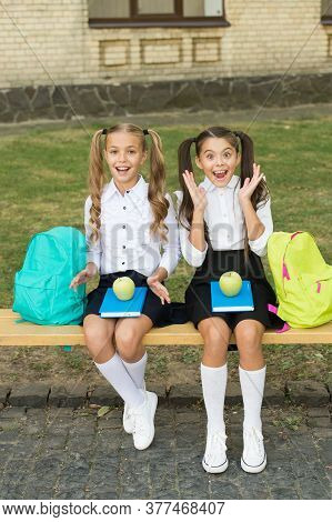 Fresh And Healthy. Happy Girls Sit On Bench Outdoors. Apples For School Snack. Healthy Diet. Vegetar