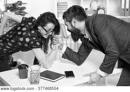 Whos Stronger. Bearded Man And Sexy Woman Arm Wrestle In Office. Workplace Relationship. Competitive