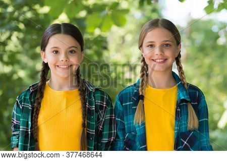 Warm Smile. Wearing Denim Clothes. Girls Teenagers Spend Time Together Having Fun. Childhood Lifesty