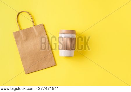 Sustainable Bamboo Reusable Coffee Cup For Travel To Go And Paper Kraft Bag. Takeaway Mug With Spill