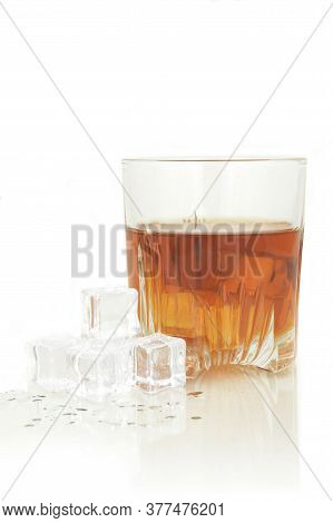 An Isolated Glass Of Scotch On The Rocks.