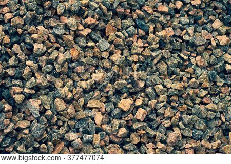 Small Broken Stones Used For Construction. Natural Material For Columns And Bases Of Buildings.