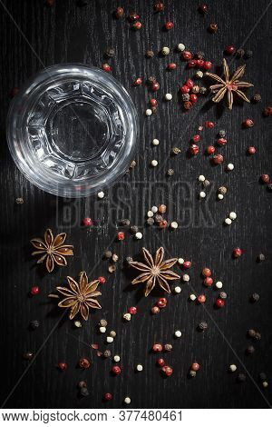 Anise Vodka In A Glass On A Wooden Surface