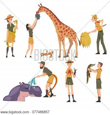 Professional Zoo Workers Caring Of Wild Animals In Zoo, Male And Female Veterinarian Or Zookeeper Ch
