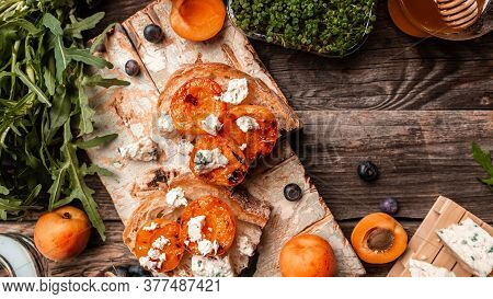 Crostini With Peaches And Blue Cheese On The Rustic Wooden Background. Banner, Catering Menu Recipe