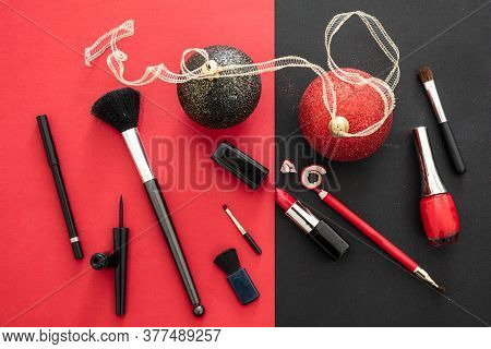 Make-up Accessories And Xmas Decoration Against Red And Black Background, Copy Space