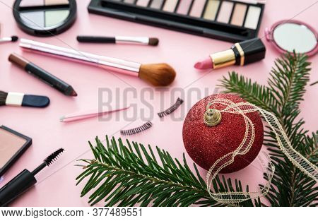 Make Up Xmas Cosmetics Products Against Pink Color Background
