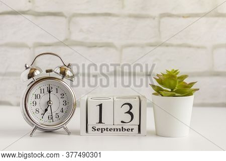 September 13 On A Wooden Calendar Next To The Alarm Clock.september Day, Empty Space For Text.calend